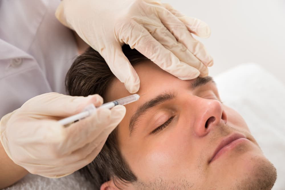 Man receiving facial fillers