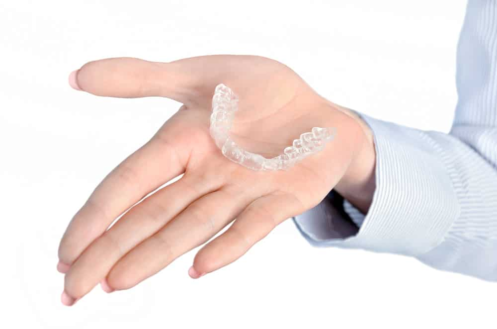 A retainer being held in someone's hand
