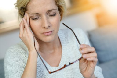 Middle-aged woman having a migraine