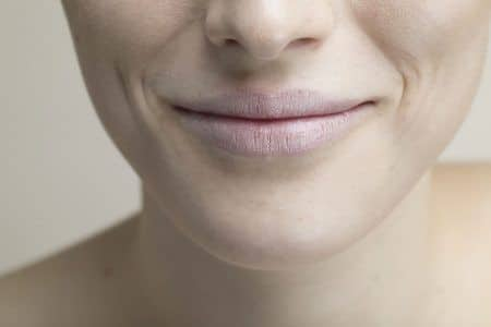 Bottom half of a female face smiling