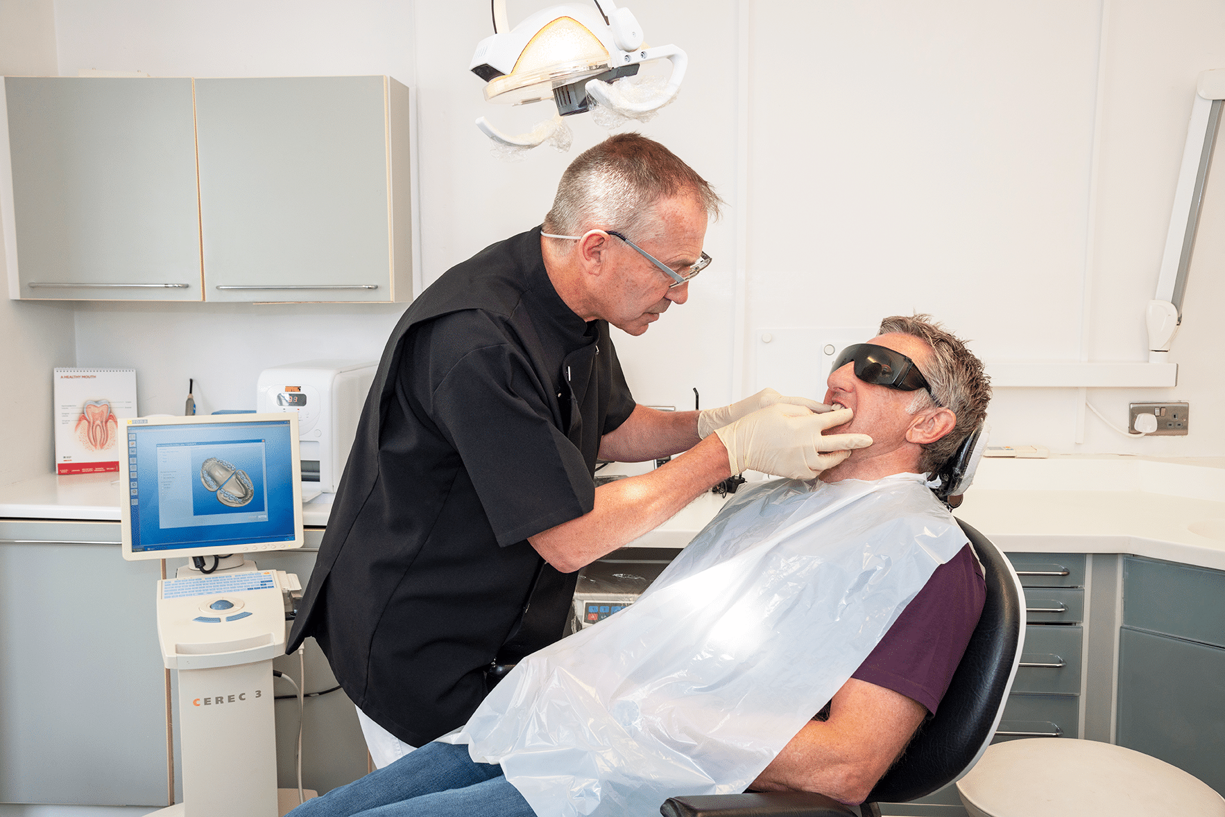 Dental Treatment - Dentist with Patient in Chair